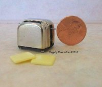 Silver Toaster w/Toast