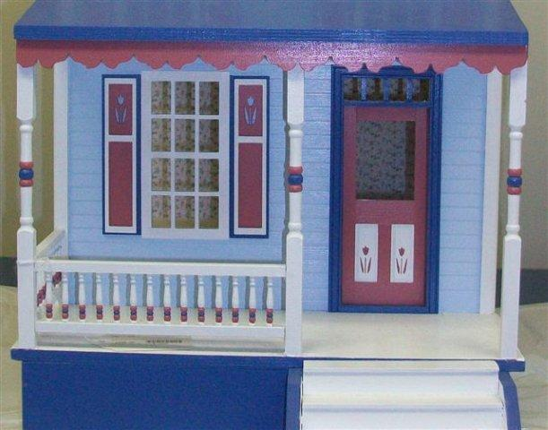 Detail painting on dollhouse